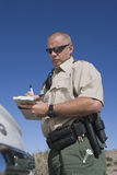 Officer Writing Ticket Stock Images