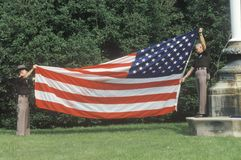 Officers Folding the American Flag Stock Images