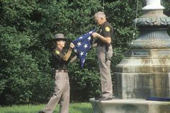 Officers Folding the American Flag Stock Image