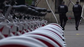 Officers going to police station near bicycle parking, city patrol on duty. Stock footage stock video