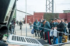Officers of Kazakh army examine troop-carrier Stock Photo
