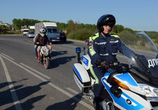 Officers of the motorized units of the road police detained the Teens on a scooter. Stock Images
