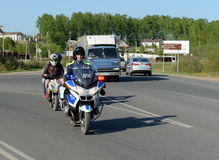 Officers of the motorized units of the road police detained the Teens on a scooter. Royalty Free Stock Photo