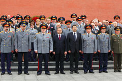 Officers and veterans stand near Kremlin wall Stock Images