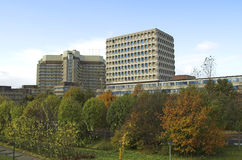 Offices. Office district landscape with two prominent builidngs and autumnal vegetation Stock Images