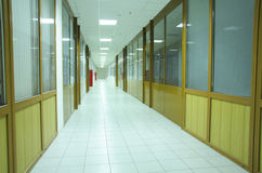 Offices. Corridor with row of offices in empty busioness center Royalty Free Stock Image