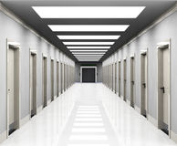 Offices. A corridor with office doors, entrances and a lift in the end Royalty Free Stock Photo