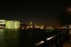 Offices II. View over the Thames at night with offices in the background Royalty Free Stock Images