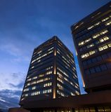 Offices by Night. A night-time officebuilding with lights in the windows Royalty Free Stock Photos