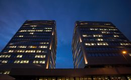 Offices by Night. A night-time officebuilding with lights in the windows Royalty Free Stock Images