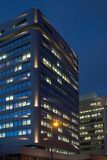 Offices by Night. A night-time officebuilding with lights in the windows Stock Images