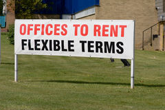 Offices to Rent - Flexible Terms sign Royalty Free Stock Photos
