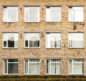 Offices with wall windows. Wall of a residential block of flats with windows Royalty Free Stock Photos