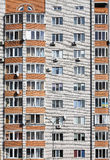Offices with wall windows. Wall of a residential block of flats with windows Royalty Free Stock Images