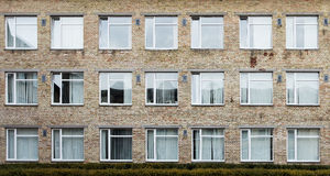 Offices with wall windows. Wall of a residential block of flats with windows Royalty Free Stock Photography