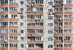 Offices with wall windows. Wall of a residential block of flats with balconies windows Royalty Free Stock Photos