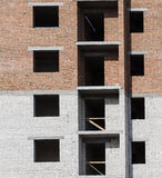 Offices with wall windows. Wall of a residential block of flats with balconies windows Stock Photography