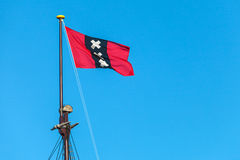 The official Amsterdam flag on top of the mast of a sailship Royalty Free Stock Images