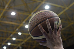 Official basket ball in referee hand Stock Images