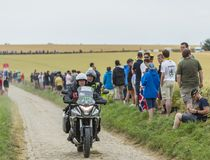 Official Bike on a Cobblestone Road - Tour de France 2015. Quievy,France - July 07, 2015: Official bike of a photographer driving on a cobblestoned road during Stock Images