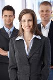 Official business team portrait. Confident, smiling businesspeople standing in office Stock Images