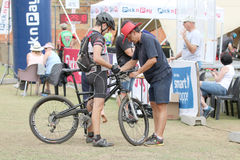 Official clocking rider's time at finish line at Mountain Bik Stock Images