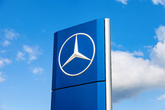 Official dealership sign of Mercedes-Benz over blue sky. SAMARA, RUSSIA - MAY 22, 2016: Official dealership sign of Mercedes-Benz over blue sky. Mercedes-Benz is Stock Image