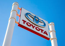 Official dealership sign of Toyota against the blue sky backgrou. SAMARA, RUSSIA - MAY 14, 2016: Official dealership sign of Toyota against the blue sky Stock Photos