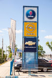Official dealership signs and flags against blue sky. SAMARA, RUSSIA - MAY 24, 2014: Official dealership signs and flags against blue sky Stock Photo