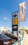 Official dealership signs and flags against blue sky. SAMARA, RUSSIA - MAY 24, 2014: Official dealership signs and flags against blue sky Royalty Free Stock Photos