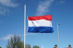 National flag of the Netherlands, half-staff. Official flag of the Netherlands, hanging half-staff as a symbol of respect stock photography
