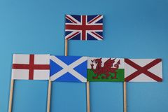 A official flag of United kingdom and flags of her members. Scotland, England, Wales, nothern Ireland. All is on blue background royalty free stock image