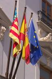 Official flags in the Valencian Community in Spain. Building with the flags of the Comunitat Valenciana, the flag of the Kingdom of Spain and the blue flag of royalty free stock photos