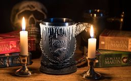 Official House Stark tankard from Game of Thrones series lit by candlelight. MORGANTOWN, WV - 26 SEPTEMBER 2018: Official Winter is Coming tankard from HBO royalty free stock images