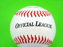 Official league. Baseball with red stitches and official league sign isolated on white Royalty Free Stock Photo
