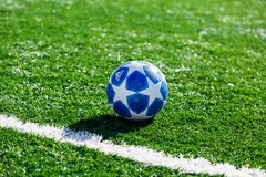Official match ball of UEFA Champions League season 2018/19 Adidas Finale Top training on grass stock image