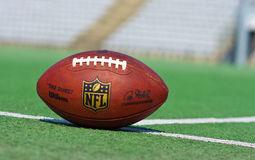 Official NFL ball. ZAGREB , CROATIA - 13 AUGUST 2015 -  official ball of the NFL football league , the Duke on grass turf background , product shot Royalty Free Stock Photo