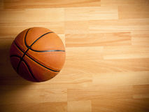 An official orange ball on a basketball court Royalty Free Stock Images