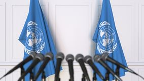 The United Nations official press conference. Flags of the UN and microphones. Conceptual editorial animation. Official press conference. Flags and microphones stock video footage