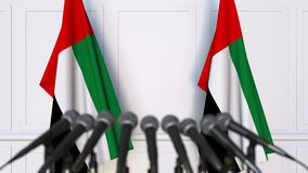 Official press conference. Flags of the United Arab Emirates UAE and microphones. Conceptual animation. Official press conference. Flags and microphones stock video