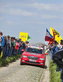 Official Red Car on the Roads of Paris Roubaix Cycling Race Royalty Free Stock Photos