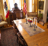 Official room with California and US flags. Furnished in retro style this luxurious meeting room from the early 1900 is very elegant and well preserved Royalty Free Stock Image
