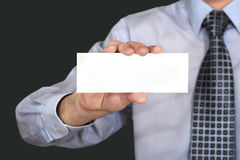 The official styled person with blank card. The fragment of official atyled person with blank white card in his arm Royalty Free Stock Photography