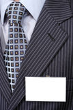 Official suit fragment with blank badge on it. Royalty Free Stock Image