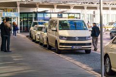 Official taxi drivers waiting for passengers. Munich, Germany - October 14, 2017: Official taxi drivers waiting for passengers before leaving the airport Royalty Free Stock Image