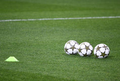 Official UEFA Champions League balls on the grass Royalty Free Stock Photos