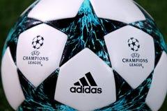 Official UEFA Champions League match ball. KHARKIV, UKRAINE - NOVEMBER 1, 2017: Close-up official UEFA Champions League match ball on the grass during UEFA Stock Photos