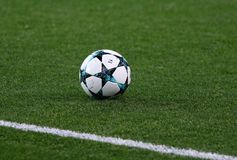 Official UEFA Champions League match ball. KHARKIV, UKRAINE - NOVEMBER 1, 2017: Official UEFA Champions League match ball on the grass during UEFA Champions Royalty Free Stock Images