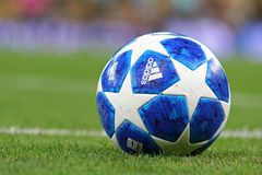 Official UEFA Champions League 2018/19 match balls. KYIV, UKRAINE - AUGUST 28, 2018: Official UEFA Champions League 2018/19 season match ball on the grass during royalty free stock images