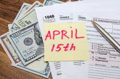 Official USA tax form 1040, calculator, pen and dollar Stock Image
